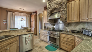 Granite countertops, solid hickory cabinets, a commercial gas stove and top-of-the-line Kitchen Aid stainless steel appliances, including a trash compactor.